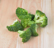 Fresh broccoli on a wooden table. Fresh broccoli on the wooden table Royalty Free Stock Photography
