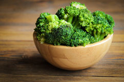 Fresh broccoli on wooden table Royalty Free Stock Photos