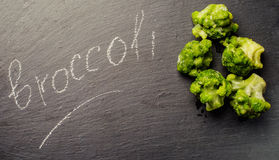 Fresh broccoli on the wooden table Royalty Free Stock Image