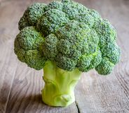Fresh broccoli on the wooden table. Close up Royalty Free Stock Photos
