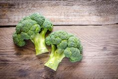 Fresh broccoli on the wooden table. Close up Stock Photos