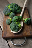 Fresh broccoli on wooden table close up Stock Photo