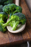 Fresh broccoli on wooden table close up.  Royalty Free Stock Photos