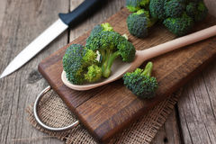 Fresh broccoli on wooden table close up.  Royalty Free Stock Images
