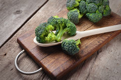 Fresh broccoli on wooden table close up.  Stock Photo