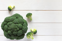 Fresh broccoli on a wooden table, top view. Fresh broccoli on a wooden table. Top view Royalty Free Stock Photos