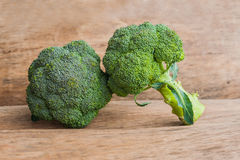 Fresh broccoli on the wooden table Royalty Free Stock Photography
