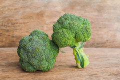 Fresh broccoli on the wooden table Royalty Free Stock Photo
