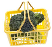 Fresh Broccoli in a Yellow Shopping Basket Stock Photography