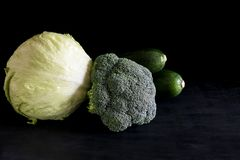 Fresh broccoli and zucchini green salad on a black background, rustic style, dark key. Green vegetables, vegetarian concept stock photo