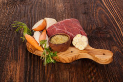 Fresh Broth Ingredients. On wooden rustic table. Fresh vegetable and raw meat on chopping board Stock Photography