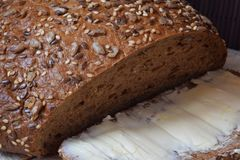 Fresh brown bread and slice with butter Stock Image