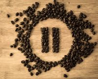 Pause Button made of Coffee Beans. Fresh Brown Coffee Beans forming Pause Button stock image