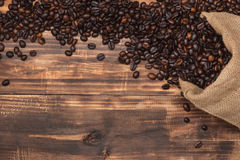 Fresh brown coffee beans on wooden background. Royalty Free Stock Photography