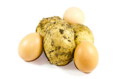 Fresh Brown Egg with Potatoes Royalty Free Stock Photography