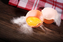 A fresh brown egg with towel Stock Photo