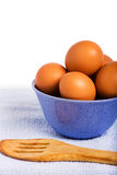 Fresh brown eggs. In blue bowl Royalty Free Stock Photo