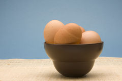 Fresh Brown Eggs. Bowl of uncooked brown eggs in a brown bowl Stock Photography