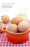 Fresh brown eggs. With milk on red gingham checked tablecloth Royalty Free Stock Photography