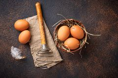 Fresh  brown eggs in bowl and whisk. Top view Stock Images