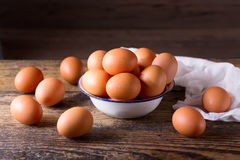 Fresh brown eggs in a bowl. Fresh eggs in a bowl on wooden table Royalty Free Stock Photo