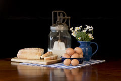 Fresh Brown Eggs and Bread. Still life of antique butter churn, fresh brown eggs and bread stock photo