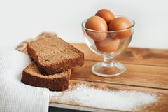 Fresh brown eggs and bread royalty free stock image