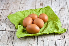 Fresh brown eggs on green napkin Royalty Free Stock Photography