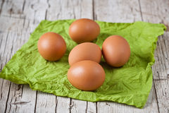Fresh brown eggs on green napkin Stock Images