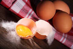 Fresh brown eggs with towel Stock Photography