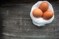 Fresh brown eggs. On a white cheesecloth on the dark wooden background. Easter concept Stock Photography