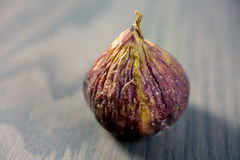 Fresh brown fig on a gray wooden table Stock Photo