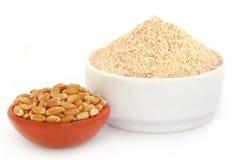Fresh brown flour with wheat Stock Photo