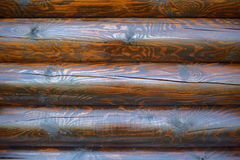 Fresh brown paint on log wall Stock Photo