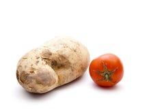 Fresh Brown Potato with Tomato Royalty Free Stock Photo