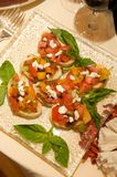 Fresh bruschetta with basil garnishes Stock Photography