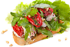Fresh bruschetta. With cheese and sun-dried tomatoes Royalty Free Stock Photography