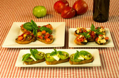 Fresh bruschetta tomatoes cheese basil and wine Stock Image