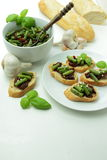 Fresh bruschettas with green bean and sundried tomato Royalty Free Stock Photos