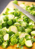 Fresh Brussel Sprouts on Cutting Board Stock Photography