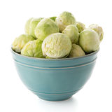 Fresh brussels sprouts. On blue ceramic bowl isolated on white background Stock Photography