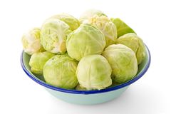 Fresh brussels sprouts. On blue metal bowl isolated on white background Royalty Free Stock Photography