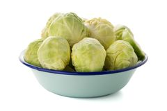 Fresh brussels sprouts. On blue metal bowl  on white background Stock Image