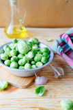 Fresh Brussels sprouts in a bowl. Food closeup Royalty Free Stock Image