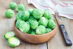 Fresh brussels sprouts in a bowl on wooden background, horizontal. Fresh brussels sprouts in bowl on wooden background, horizontal Royalty Free Stock Image