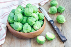 Fresh brussels sprouts in a bowl on wooden background, horizontal. Fresh brussels sprouts in bowl on wooden background, horizontal Royalty Free Stock Photography