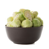 Fresh brussels sprouts. On brown ceramic bowl isolated on white background Royalty Free Stock Photography