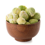 Fresh brussels sprouts. On brown wood bowl isolated on white background Royalty Free Stock Images