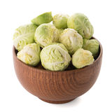 Fresh brussels sprouts. On brown wood bowl isolated on white background Royalty Free Stock Photos