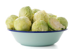 Fresh brussels sprouts. On blue metal bowl  on white background Stock Photography